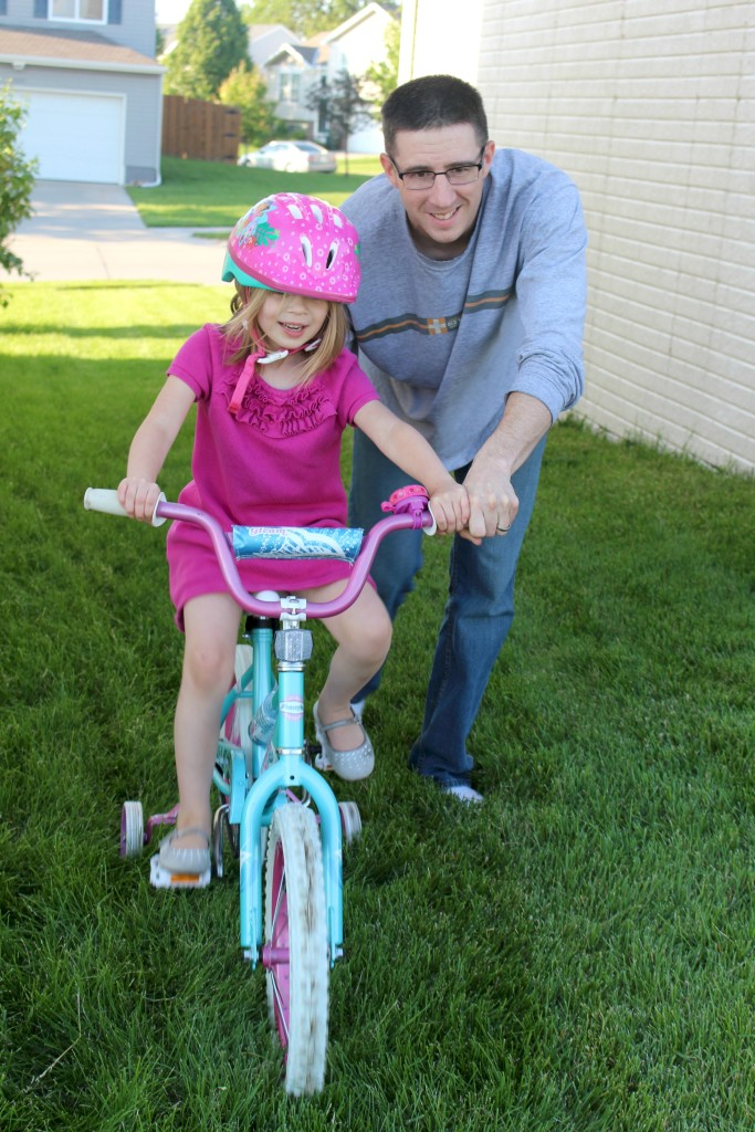 Nick helping Lena ride bike