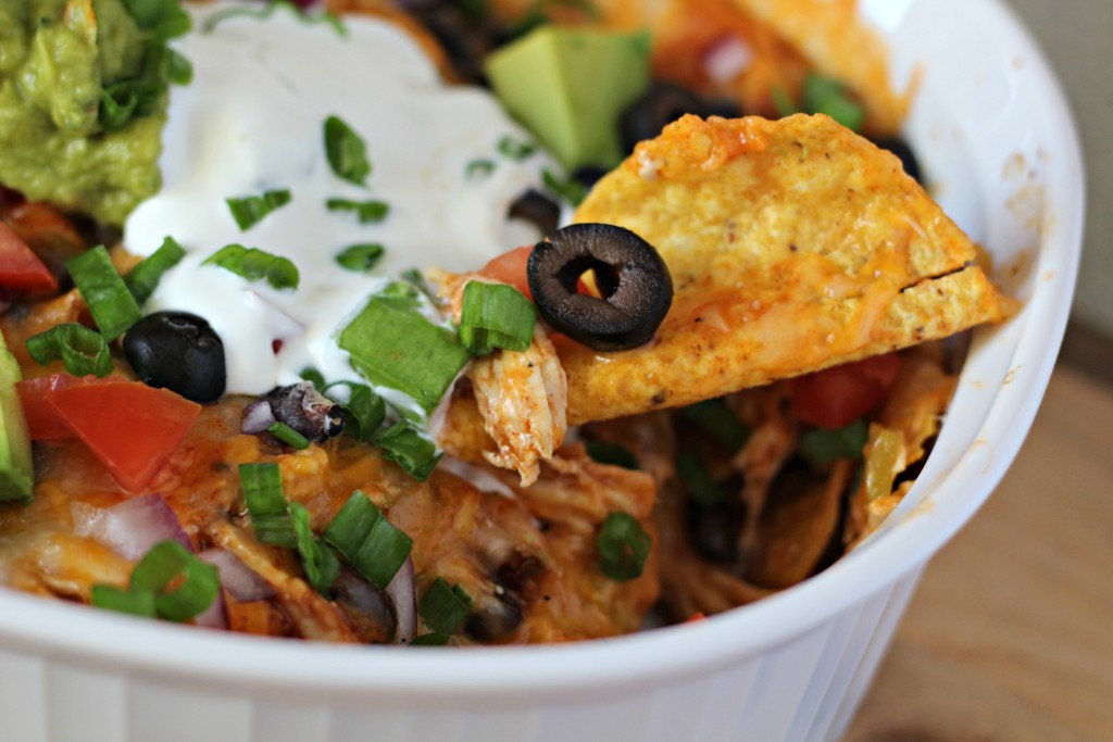 This Chicken Enchilada Nachos recipe is perfect for a lunch, dinner, or snack. It's also great as a game day snack to munch on while watching the big game!