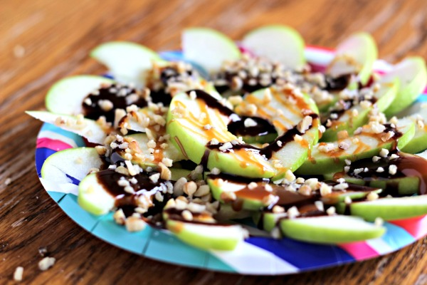 Turn your apples into a fun dessert nacho bar. Use the basic toppings of caramel and nuts, or get creative with candy bars, cookies, sprinkles and more.